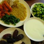 Vegetarian Indian meal with Dal, rice,green beans, squash, cucumber,yogurt, and dates