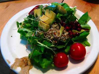raw-salad-avocado-pomegranate-lettuce-cherry-tomato-sprouts