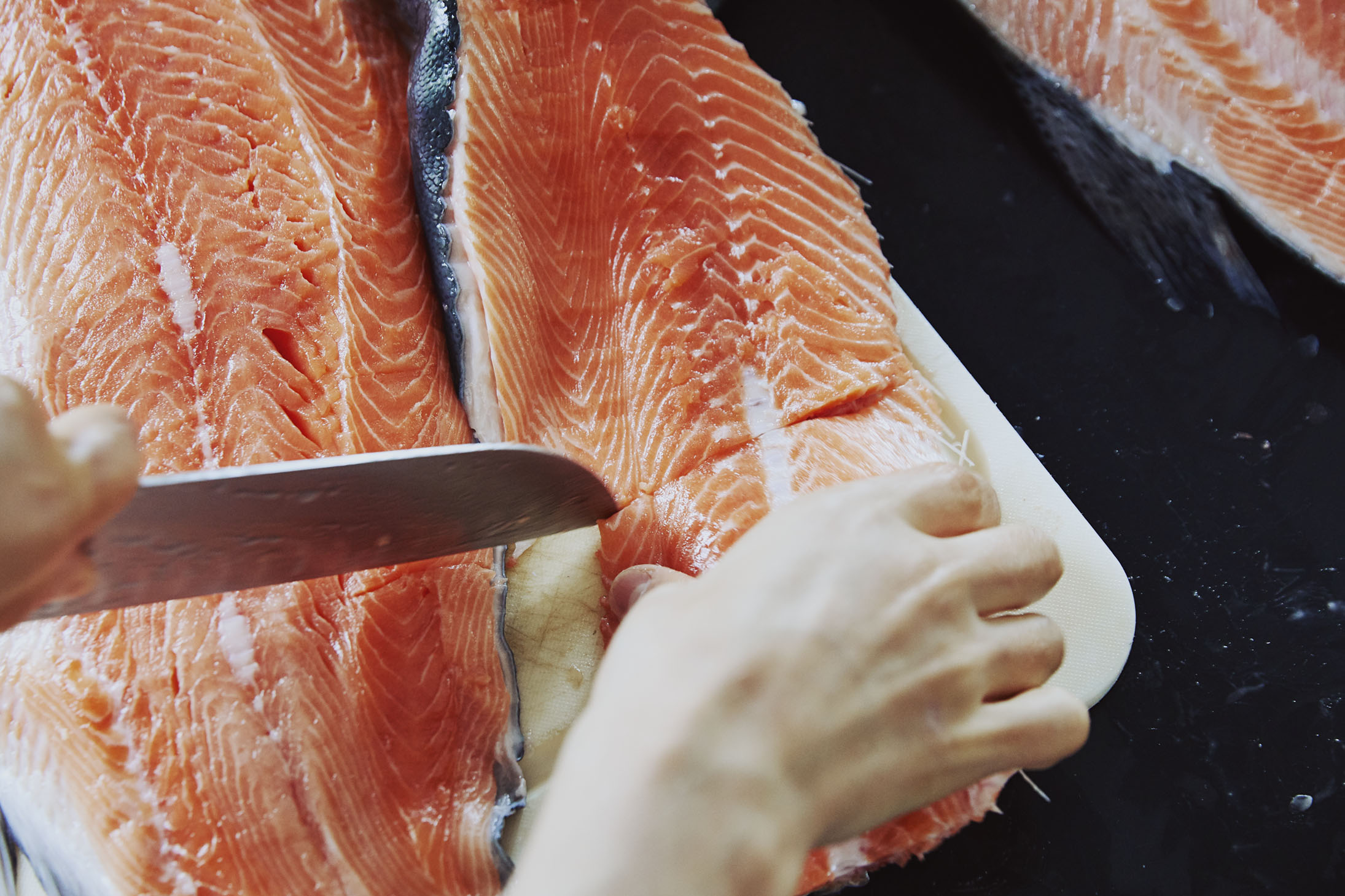 Salmon filleting a whole fish sustainable