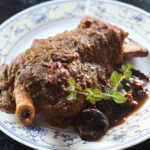braised lamb shoulder bone-in with dried apricots and spices